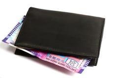 Carpeta negra con diez dólares de HK fotografía de archivo libre de regalías