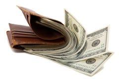 Carpeta por completo de dinero Foto de archivo libre de regalías