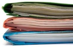 Carpeta roja, verde y azul (vista lateral) Imagenes de archivo