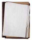 Carpeta vieja con la pila de papeles viejos Foto de archivo