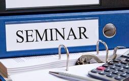 Carpeta y calculadora del seminario Imagen de archivo libre de regalías