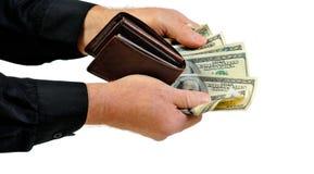 Carpeta y dinero de ofrecimiento del hombre Imagen de archivo libre de regalías