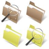 Carpeta y lupa Imagen de archivo libre de regalías