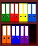 Carpetas coloreadas de la oficina Imágenes de archivo libres de regalías