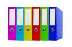 Carpetas coloridas de la oficina aisladas en blanco Imágenes de archivo libres de regalías