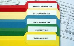 Carpetas de fichero de impuestos Imagen de archivo libre de regalías