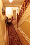 Carpeted Hallway & Stairs in Quaint Old Home Royalty Free Stock Photography