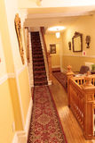 Carpeted Hallway & Stairs in Quaint Old Home Royalty Free Stock Image