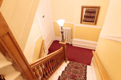 Carpeted Hallway & Stairs in Quaint Old Home Royalty Free Stock Photos