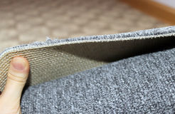 Carpeting. A grey roll of carpeting with short pile Stock Photo