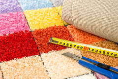 Carpeting knife, swatches and tape measure. Carpeting colorful swatches, boxcutter and tape measure Royalty Free Stock Image