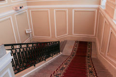 The carpeting on the main staircase. stock photography