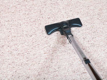 Carpeting vacuuming with vacuum cleaner. At home Stock Photos