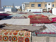 Carpets drying on the terrace in Tunisia. Carpets drying on the roof terrace in medina Tunisia Royalty Free Stock Image