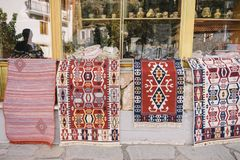 Display of carpets in Arachova, Greece. Carpets in front of a store Stock Image