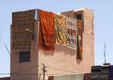 Carpets haning from a roof top. Carpets hanging from a roof top in the Medina Marrakesh Morocco Stock Image