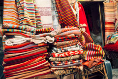 Carpets and kilims with ancient drawings in small souvenir shop of bazaar street Stock Images