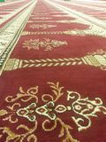 Carpets of a Mosque. Beautiful designs on the carpet row in a mosque in Tampa Florida Royalty Free Stock Photography