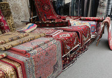 Carpets for sale in the ethnic market stall Royalty Free Stock Image