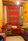 Textile shop in morocco. Carpets, scarfs and blankets piled in a moroccan textile shop Stock Photo