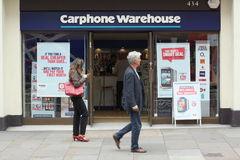 Carphone Warehouse London. London, England - Sept 11th, 2014: People walking by the Carphone Warehouse store in Central London. The UK company was founded in Stock Photos