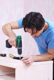 Carpinteiro com broca Fotografia de Stock Royalty Free