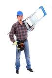 Carpinteiro com a escada no branco Foto de Stock Royalty Free