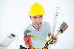 Carpinteiro com vário equipamento Fotografia de Stock Royalty Free