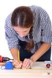 Carpinteiro da mulher no trabalho Imagens de Stock Royalty Free