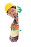 Carpinteiro que mostra o sinal vazio Fotografia de Stock
