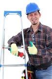 Carpintero alegre que muestra los pulgares para arriba fotografía de archivo libre de regalías