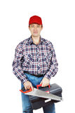 Carpintero con el handsaw y la caja de herramientas Foto de archivo libre de regalías