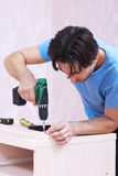 Carpintero con el taladro Fotografía de archivo libre de regalías