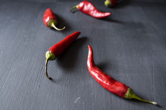 Red hot peppers. On a black background Royalty Free Stock Photography