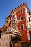 Carrara. (Massa , Tuscany, Italy) - The giant statue with in background the Michelangelo house Stock Image