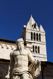 Carrara. (Massa , Tuscany, Italy) - The giant statue with in background the Cathedral Stock Photography