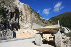 A dumper truck used in a Carrara marble quarry. Large yellow dum royalty free stock image
