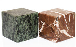 Carrara marble. Green and red isolated cube of carrara marble royalty free stock photos