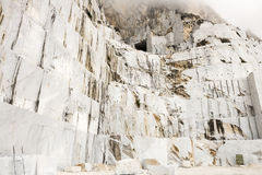 Carrara Marble quarries. The mountain face of a white marble quarry Royalty Free Stock Photos