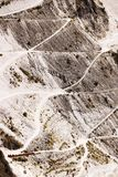 Carrara marble quarries on the mountains of the Apuan Alps. Roads of access to places of extraction stock photography