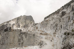 Carrara Marble quarries. Top of a marble mountain with transport machines Stock Photo