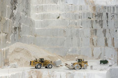 Carrara Marble quarries. Two transporters in a marble quarry Royalty Free Stock Photo