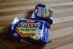 Carre Hazelnut Waffer Slice. Romania, Bucharest- 13 June 2016- The caption represents Carre, Hazelnut Waffer Slice which is a food product made by Sondey and Royalty Free Stock Images
