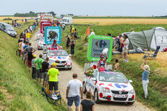 Carrefour Caravan on a Cobblestone Road- Tour de France 2015 Royalty Free Stock Photo