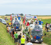 Carrefour Caravan on a Cobblestone Road- Tour de France 2015 Stock Photography