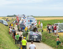 Carrefour Caravan on a Cobblestone Road- Tour de France 2015 Stock Image