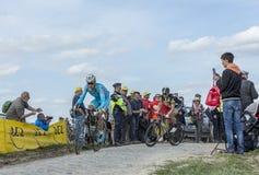 Two Cyclists - Paris Roubaix 2015. Carrefour de l`Arbre, France - April 12,2015: Daniil Fominykh of Team Astana and Jay Robert Thomson of MTN-Qhubeka Team Stock Photos