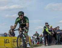 The Cyclist Morgan Lamoisso - Paris Roubaix 2015. Carrefour de l`Arbre, France - April 12,2015: The French cyclist, Morgan Lamoisso of Team Europcar, riding in Royalty Free Stock Photos