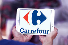 Carrefour logo. Logo of the international chain of convenience stores  carrefour on samsung tablet Stock Image