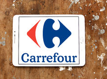Carrefour logo. Logo of the international chain of convenience stores  carrefour on samsung tablet on wooden background Stock Photography